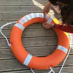Adding vinyl lettering to the lifebuoy