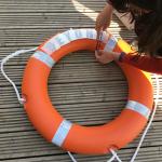 Adding vinyl lettering to the lifebuoy